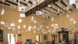 Exposición de fotos durante el aperitivo (Foto de Fotos NO: Juan Miguel Pla Jorrín y Maribel Mata)